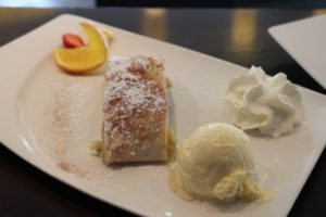 Hotel Pinzger Tux apple strudel with vanilla sauce city bar