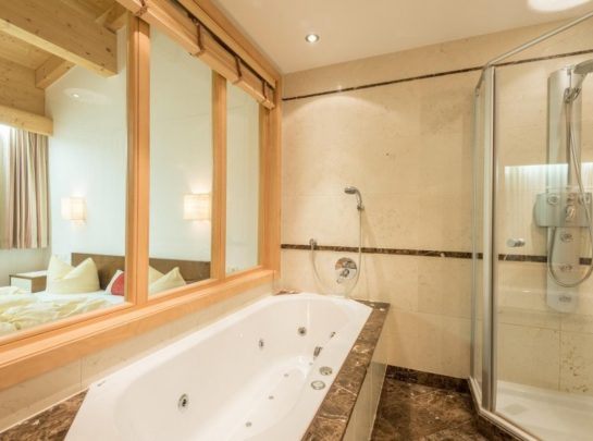 Hotel Pinzger Tux Rastkogel Suite with jacuzzi bathtub and rainfall shower